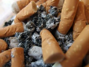 Cigarette Butts in Ashtray 300x225 Tired of Smoking